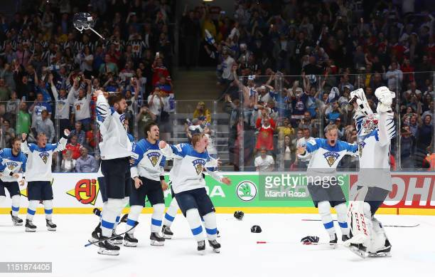 Kevin Lankinen goaltender of Finland celebrate with his team mates after winning the gold medal game over Canada during the 2019 IIHF Ice Hockey...
