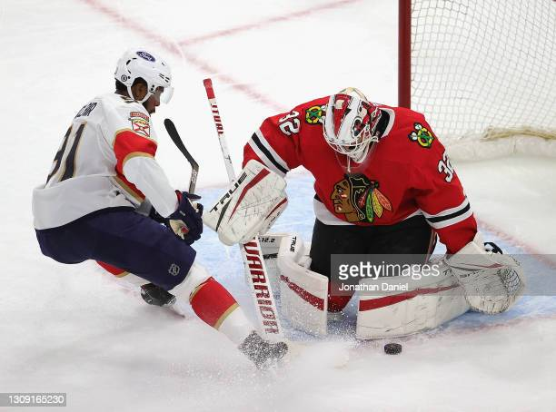 Kevin Lankinen of the Chicago Blackhawks makes a save against Anthony Duclair of the Florida Panthers at the United Center on March 25, 2021 in...