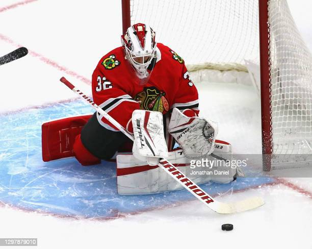 Kevin Lankinen of the Chicago Blackhawks makes a save against the Detroit Red Wings at the United Center on January 22, 2021 in Chicago, Illinois.