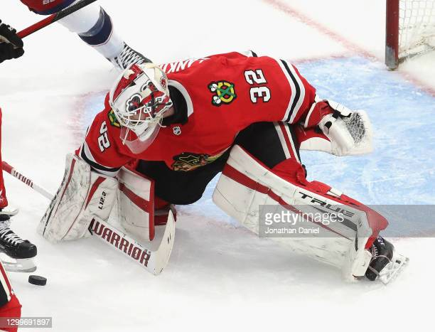 Kevin Lankinen of the Chicago Blackhawks makes a save against the Columbus Blue Jackets at the United Center on January 31, 2021 in Chicago,...