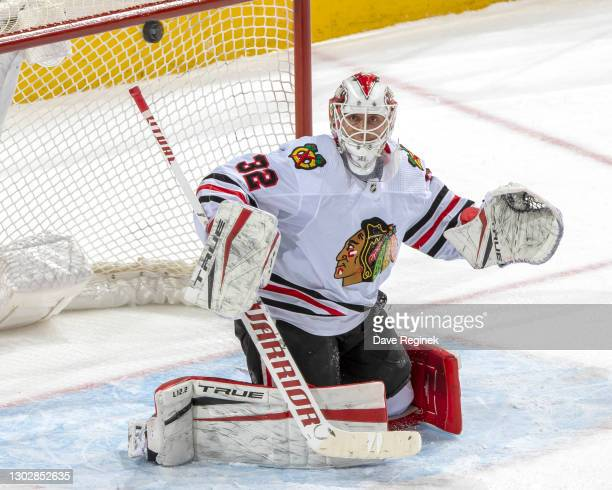 Kevin Lankinen of the Chicago Blackhawks makes a save against the Detroit Red Wings during an NHL game at Little Caesars Arena on February 17, 2021...