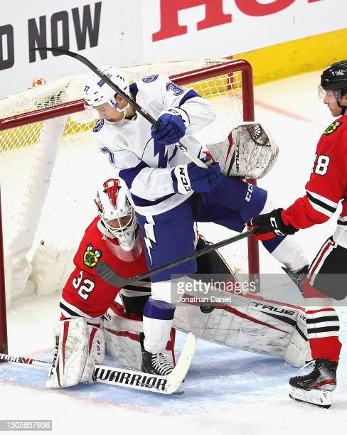 Kevin Lankinen of the Chicago Blackhawks makes a save against Yanni Gourde of the Tampa Bay Lightning at the United Center on March 07, 2021 in...