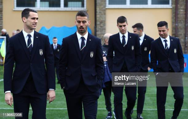 Kevin Lasagna and Leonardo Spinazzola walk on the pitch during Italy team photo with the new Armani suit at Centro Tecnico Federale di Coverciano on...