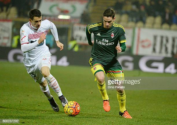 Kevin Lasagna of Carpi FC competes with Mattia De Sciglio of AC Milan during the Serie A match between Carpi FC and AC Milan at Alberto Braglia...