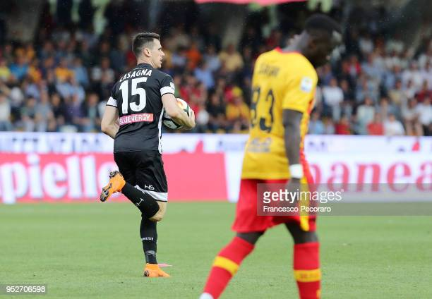 Kevin Lasagna of Udinese Calcio celebrates after scoring the 22 goal beside the disappointment of Bacary Sagna of Benevento Calcio during the serie A...