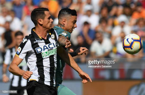 Kevin Lasagna of Udinese Calcio competes for the ball with Armando Izzo of Torino FC during the serie A match between Udinese and Torino FC at Stadio...