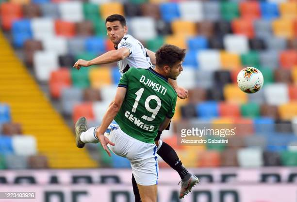 Kevin Lasagna of Udinese Calcio competes for the ball with Berat Djimsiti of Atalanta BC during the Serie A match between Udinese Calcio and Atalanta...