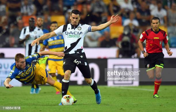Kevin Lasagna of Udinese Calcio competes for the ball with Dejan Kulusevski of Parma Calcio during the Serie A match between Udinese Calcio and Parma...