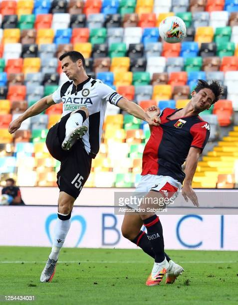 Kevin Lasagna of Udinese Calcio competes for the ball with Edoardo Goldaniga of Genoa CFC during the Serie A match between Udinese Calcio and Genoa...