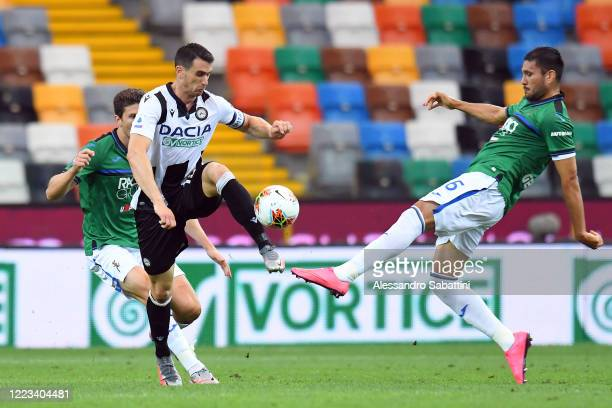 Kevin Lasagna of Udinese Calcio competes for the ball with Josè Palomino of Atalanta BC during the Serie A match between Udinese Calcio and Atalanta...
