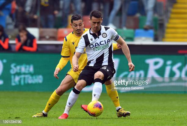 Kevin Lasagna of Udinese Calcio competes for the ball with Koray Gunter of Hellas Verona during the Serie A match between Udinese Calcio and Hellas...