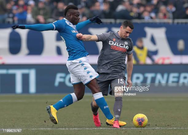 Kevin Lasagna of Udinese Calcio competes for the ball with Mario Balotelli of Brescia Calcio during the Serie A match between Brescia Calcio and...