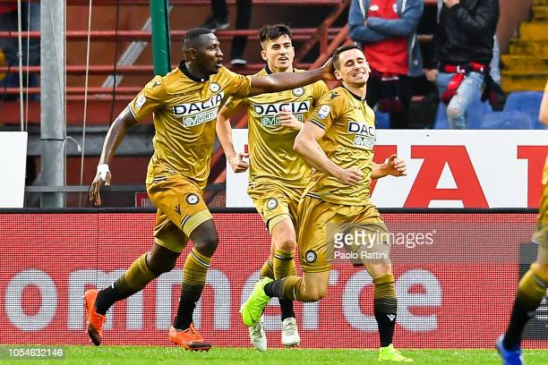 Kevin Lasagna of Udinese celebrates with his teammates Nicholas Opoku and Ignacio Pussetto of Udinese after scoring a goal during the Serie A match...