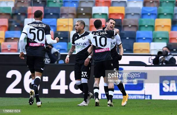 Kevin Lasagna of Udinese celebrates with team mates Rodrigo Becao, Roberto Pereyra and Rodrigo De Paul after scoring their side's first goal during...