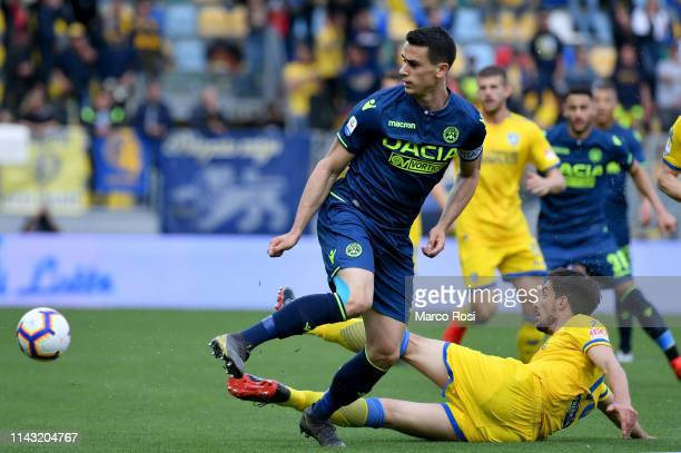 Kevin Lasagna of Udinese compete for the ball with Lorenzo Ariaudo of Frosinone during the Serie A match between Frosinone Calcio and Udinese at...