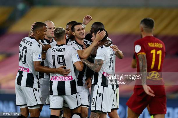 Kevin Lasagna with his teammates of Udinese Calcio celebrate after scoring the opening goal during the Serie A match between AS Roma and Udinese...