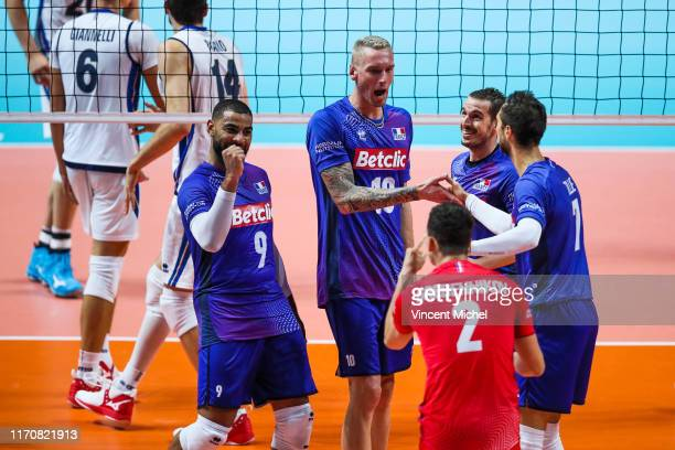 Kevin LE ROUX of France and Earvin NGAPETH of France celebrate during the EuroVolley Quarter final match between France and Italy on September 24...