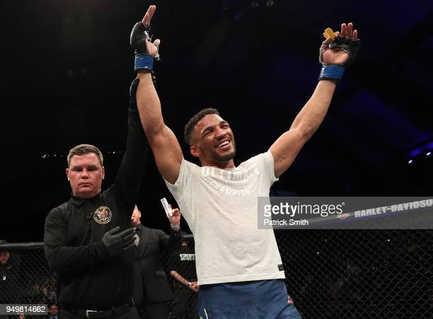 Kevin Lee celebrates after his TKO victory over Edson Barboza of Brazil in their lightweight fight during the UFC Fight Night event at the Boardwalk...
