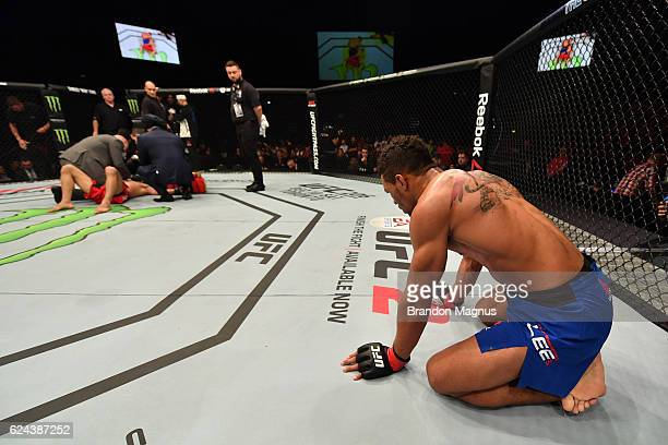 Kevin Lee celebrates his submission victory over Magomed Mustafaev of Russia in their lightweight bout during the UFC Fight Night at the SSE Arena on...