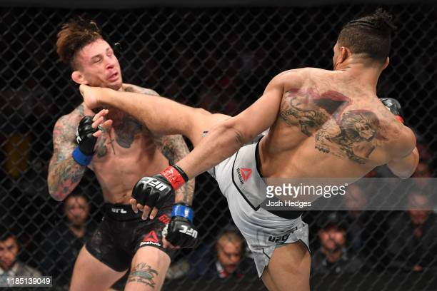 Kevin Lee kicks Gregor Gillespie in their lightweight bout during the UFC 244 event at Madison Square Garden on November 02, 2019 in New York City.