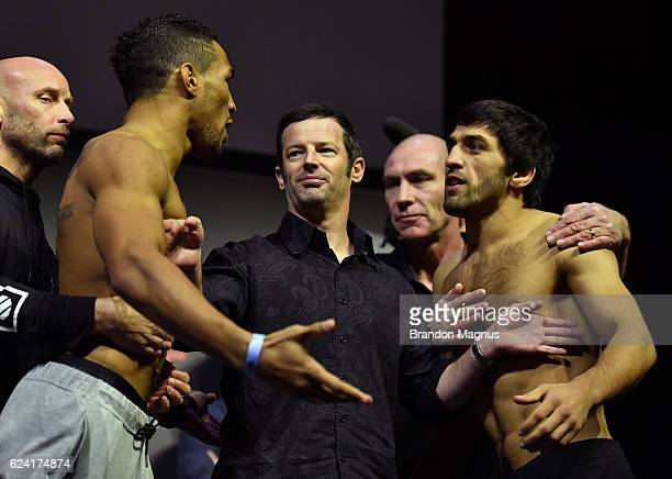 Kevin Lee of the United States and Magomed Mustafaev of Russia face off during the UFC Fight Night weighin at the SSE Arena on November 18 2016 in...