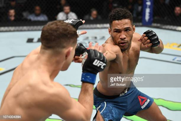 Kevin Lee punches Al Iaquinta in their lightweight bout during the UFC Fight Night event at Fiserv Forum on December 15 2018 in Milwaukee Wisconsin
