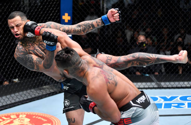 Kevin Lee punches Daniel Rodriguez in a welterweight fight during the UFC Fight Night event at UFC APEX on August 28, 2021 in Las Vegas, Nevada.