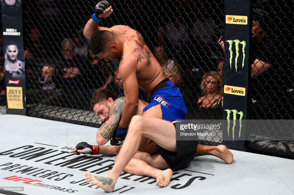 Kevin Lee punches Michael Chiesa in their lightweight bout during the UFC Fight Night event at the Chesapeake Energy Arena on June 25, 2017 in Oklahoma City, Oklahoma.