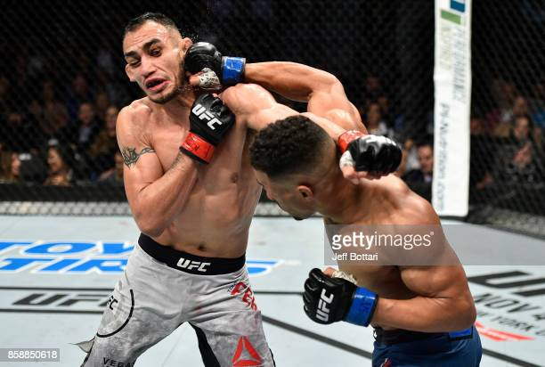 Kevin Lee punches Tony Ferguson in their interim UFC lightweight championship bout during the UFC 216 event inside TMobile Arena on October 7 2017 in...