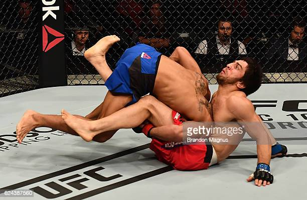 Kevin Lee takes down Magomed Mustafaev of Russia in their lightweight bout during the UFC Fight Night at the SSE Arena on November 19 2016 in Belfast...