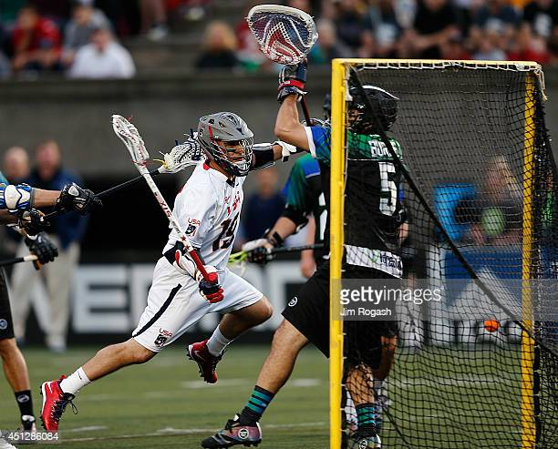 Kevin Levelle of Team USA reacts after scoring on Jordan Burke of Team MLL during the 2014 MLL All Star Game at Harvard Stadium on June 26 2014 in...