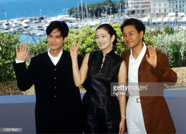 Kevin Li Gong Li and Leslie Cheung attend the 49th Cannes film Festival in May 1996 in Cannes France