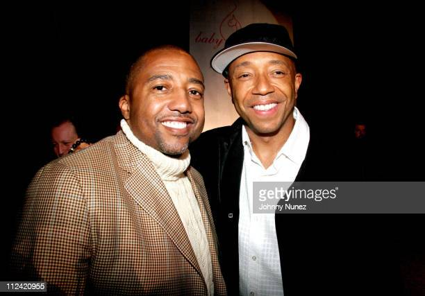 Kevin Liles and Russell Simmons during Olympus Fashion Week Fall 2006 Baby Phat Front Row and Backstage at Bryant Park in New York City New York...