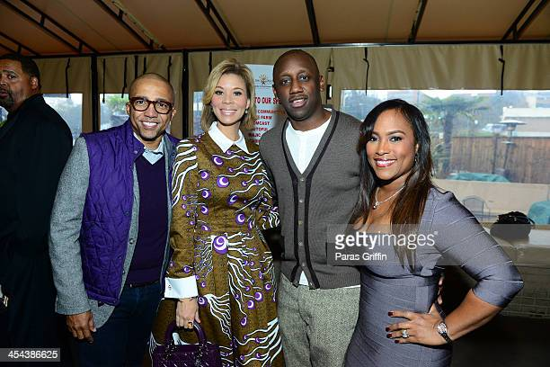 Kevin Liles Erika Liles Chaka Zulu and Tanya Ski attend the Frank Ski Celebrity Wine Tasting at Frank Ski's Restaurant on December 8 2013 in Atlanta...