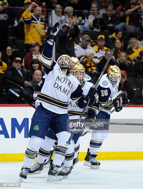 Kevin Lind of the Notre Dame Fighting Irish celebrates scoring a goal against the St Cloud State Huskies during the second period of the West...