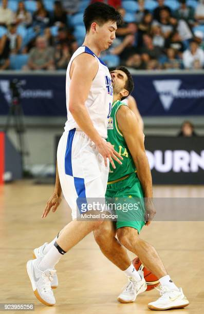 Kevin Lisch of the Boomers cops a knock to the head by Long Mao Hu of Chinese Taipei during the FIBA World Cup Qualifying match between the...