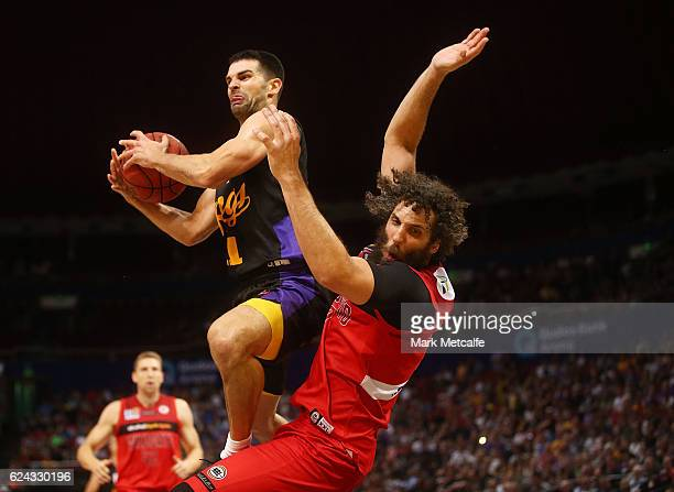Kevin Lisch of the Kings drives to the basket and is challenged by Matt Knight of the Wildcats during the round seven NBL match between the Sydney...