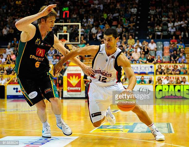 Kevin Lisch of the Wildcats drives past Cameron Tovey of the Crocodiles during the round two NBL match between the Townsville Crocodiles and the...