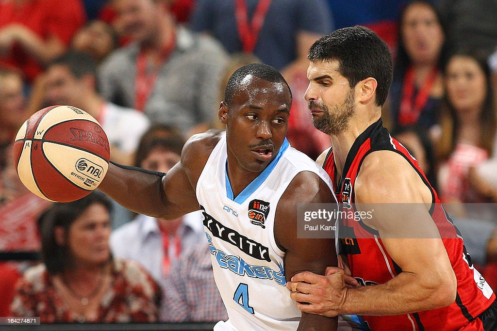Kevin Lisch of the Wildcats holds Cedric Jackson of the Breakers out of the key during the round 24 NBL match between the Perth Wildcats and the New Zealand Breakers at Perth Arena on March 22, 2013 in Perth, Australia.