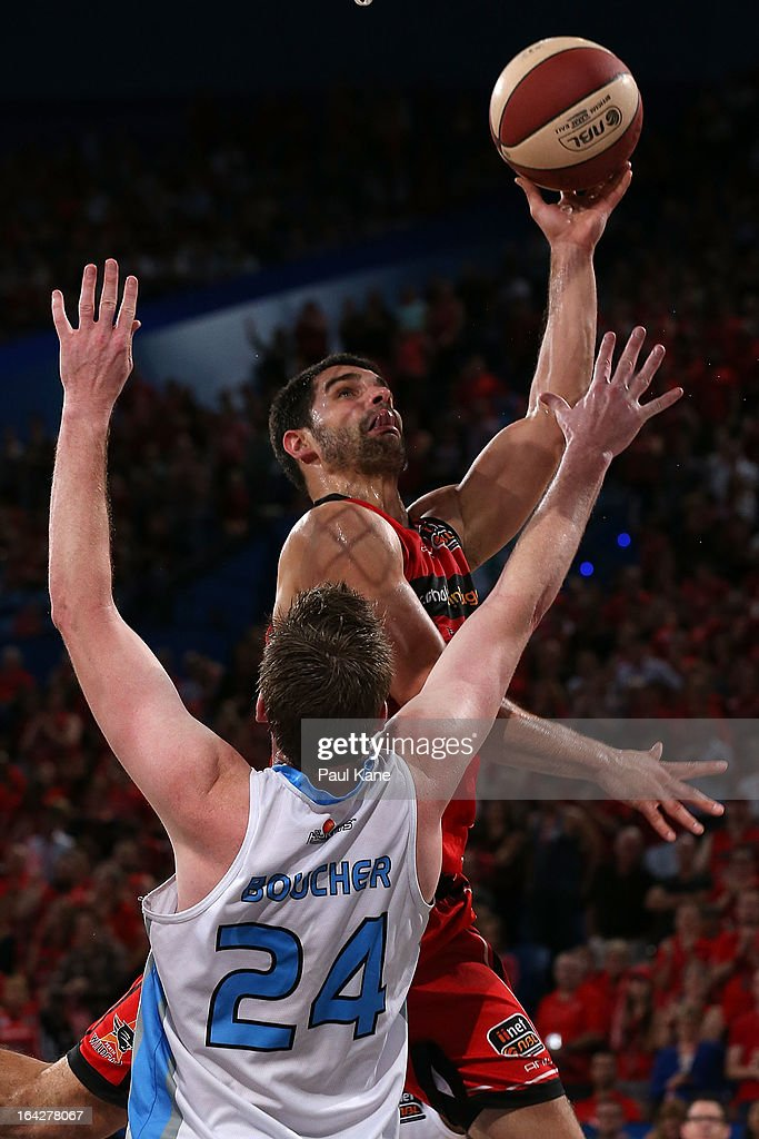 Kevin Lisch of the Wildcats lays up against Dillon Boucher of the Breakers during the round 24 NBL match between the Perth Wildcats and the New Zealand Breakers at Perth Arena on March 22, 2013 in Perth, Australia.