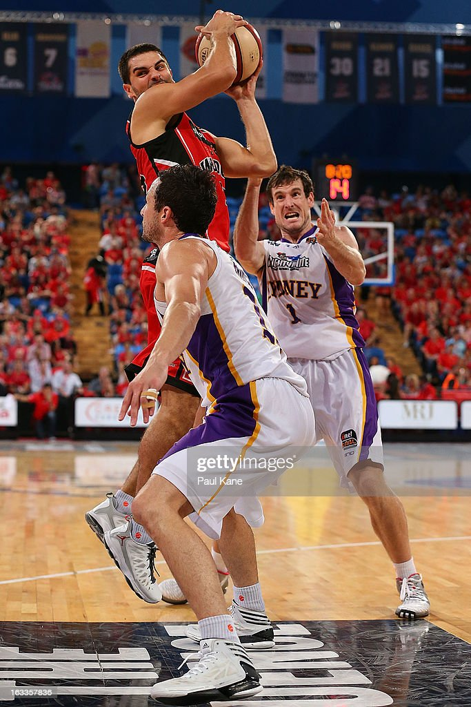 Kevin Lisch of the Wildcats passes the ball during the round 22 NBL match between the Perth Wildcats and the Sydney Kings at Perth Arena on March 8, 2013 in Perth, Australia.