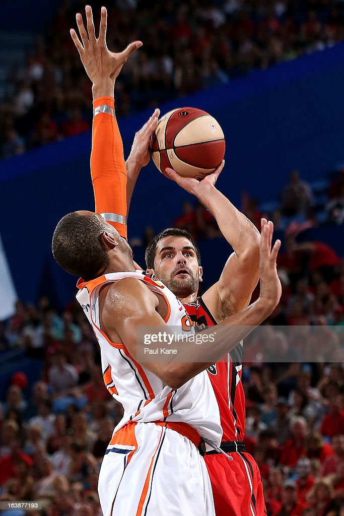 Kevin Lisch of the Wildcats shoots against Shane Edwards of the Taipans during the round 23 NBL match between the Perth Wildcats and the Cairns Taipans at Perth Arena on March 17, 2013 in Perth, Australia.
