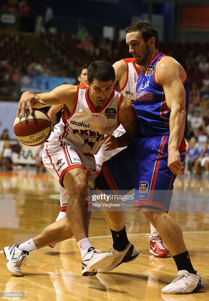 Kevin Lisch of Wildcats tries to dribble past Adam Gibson of the 36ers during the round six NBL match between the Adelaide 36ers and the Perth Wildcats at Adelaide Arena on November 11, 2012 in Adelaide, Australia.