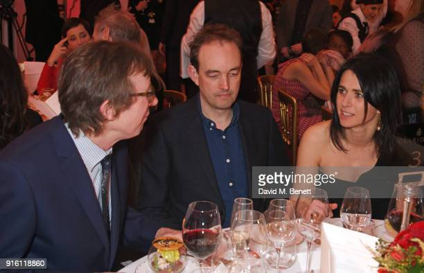 Kevin Loader Tom Mullion and Emily Sheffield attend a drinks reception at the London Evening Standard British Film Awards 2018 at Claridge's Hotel on...