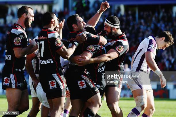 Kevin Locke of the Warriors celebrates after scoring a try during the round 20 NRL match between the New Zealand Warriors and the Melbourne Storm at...