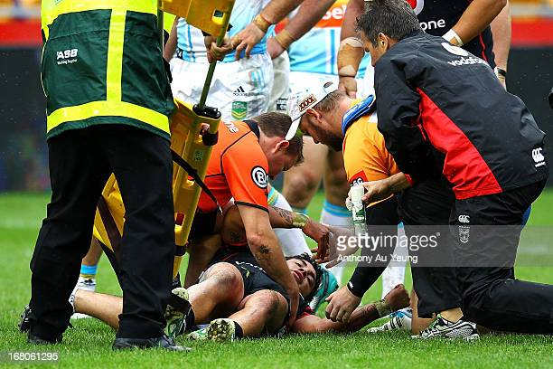 Kevin Locke of the Warriors is attended to by medical staff during the round eight NRL match between the New Zealand Warriors and the Gold Coast...