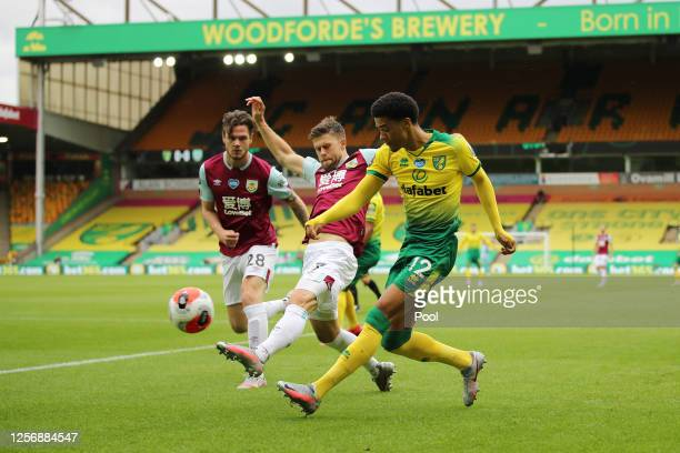 Kevin Long and Johann Berg Gudmundsson of Burnley battle for possession with Jamal Lewis of Norwich City during the Premier League match between...