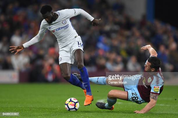 Kevin Long of Burnley attempts to tackle Tiemoue Bakayoko of Chelsea during the Premier League match between Burnley and Chelsea at Turf Moor on...