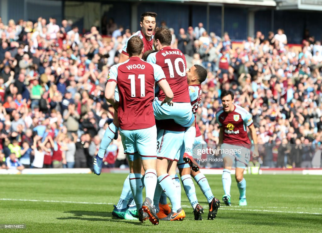 Kevin Long of Burnley celebrates with teammates after scoring his sides second goal during the Premier League match between Burnley and Leicester City at Turf Moor on April 14, 2018 in Burnley, England.