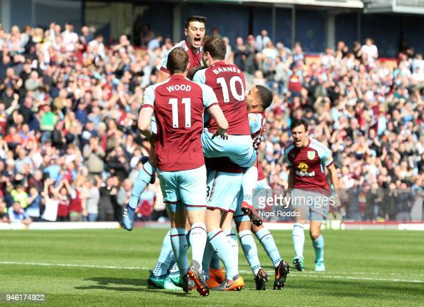 Kevin Long of Burnley celebrates with teammates after scoring his sides second goal during the Premier League match between Burnley and Leicester...